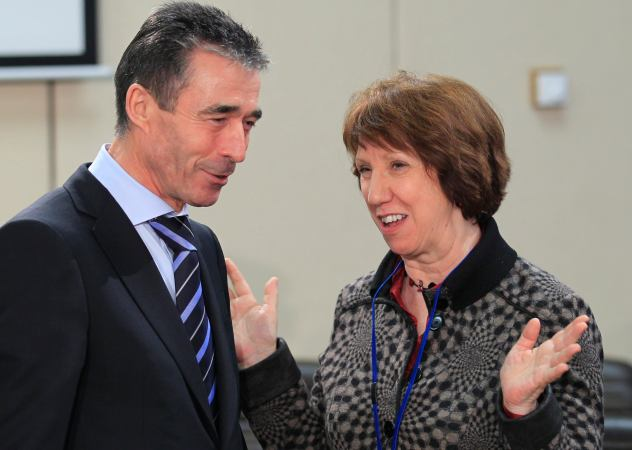 NATO Secretary-General Anders Fogh Rasmussen talks to European Union foreign policy chief Catherine Ashton during a NATO foreign ministers meeting at the Alliance's headquarters in Brussels