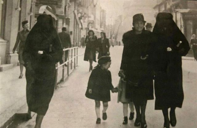 A Muslim woman covers the yellow star of her Jewish neighbour with her veil to protect her from prosecution. Sarajevo, 1941